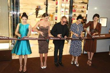 (From left) Chinese actress Gao Yuanyuan, Australian model Miranda Kerr, American fashion designer Michael Kors, Hong Kong actress Carina Lau, Taiwanese model and actress Lin Chi-ling cut ribbons at the opening ceremony for a flagship store of luxury