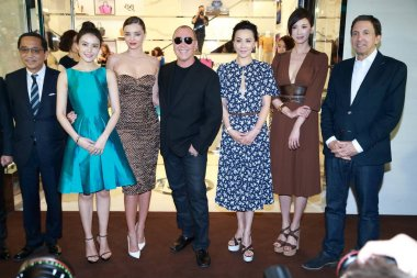 (From second left to second right) Chinese actress Gao Yuanyuan, Australian model Miranda Kerr, American fashion designer Michael Kors, Hong Kong actress Carina Lau, Taiwanese model and actress Lin Chi-ling pose during the opening ceremony for the fl