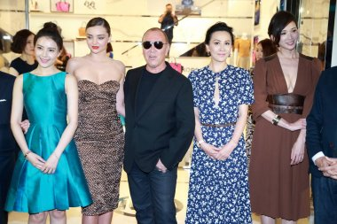 (From left) Chinese actress Gao Yuanyuan, Australian model Miranda Kerr, American fashion designer Michael Kors, Hong Kong actress Carina Lau, Taiwanese model and actress Lin Chi-ling pose during the opening ceremony for the flagship store of Michael