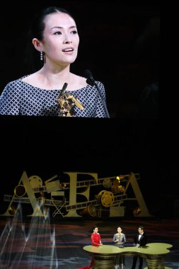 Chinese actress Zhang Ziyi, center, speaks after winning the Best Actress award for her movie, The Grandmaster, next to Hong Kong actress Carina Lau, left, and Chinese director Zhang Guoli during the 8th Asian Film Awards ceremony in Macao, China, 27