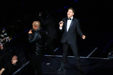 Canadian singer Michael Buble, right, performs at his concert in Shanghai, China, 13 January 2015.
