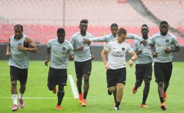 Players of Paris Saint-Germain football club attend a training session ahead of the French Super Cup soccer match against Guingamp in Beijing, China, 31 July 2014