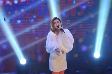 Singer Selina Jen of  Taiwanese pop girl group S.H.E performs at a promotional event for her new music album