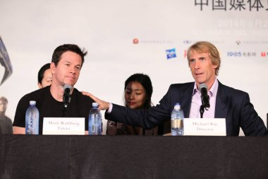 American actor Mark Wahlberg, left, and American director Michael Bay attend a press conference for their movie, Transformers: Age of Extinction, during the 17th Shanghai International Film Festival in Shanghai, China, 22 June 2014.
