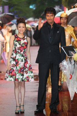 Japanese actress Aya Ueto, left, and actor Hiroshi Abe pose at a premiere for their movie, Thermae Romae II, in Taipei, Taiwan, 1 May 2014.