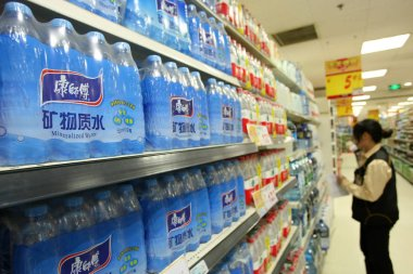 Bottles of Master Kong mineralized water of Tingyi Holding Corp. are for sale at a supermarket in Shanghai, China, 2 May 2013