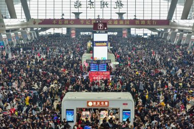 Passengers wait for their trains during the Spring Festival travel rush, also known as