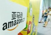 People visit the stand of amazon.cn, the Chinese shopping site of Amazon, during an exhibition in Hangzhou city, east Chinas Zhejiang province, 14 August 2014.