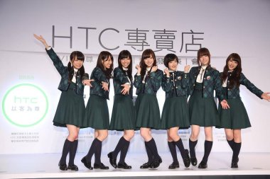 Members of Japanese female idol group Nogizaka46 pose at a promotional event for HTC smartphones and services in Taipei, Taiwan, 2 September 2014.