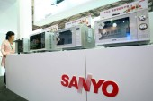 Sanyo microwave ovens manufactured by Hefei Rongshida Sanyo Electric Co., Ltd. are displayed during the China Appliance World Expo 2012 in Shanghai, China, 20 March 2012