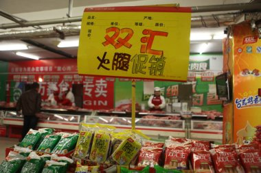Bags of Shineway sausage of Shuanghui Group, now called WH Group, are for sale at a supermarket in Rizhao city, east Chinas Shandong province, 11 July 2014.