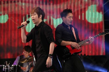 Members of Taiwanese pop group May Day perform during the premiere of their new film, Nowhere, in Taipei, Taiwan, 8 September 2013.