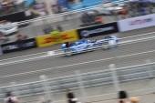 Amlin Aguri driver Takuma Sato del Giappone compete durante la gara di tutto-elettrico auto di Formula E di Pechino, 13 settembre 2014.