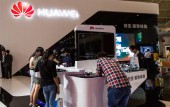 Visitors try out Huawei smartphones during PT/EXPO COMM CHINA 2012 in Beijing, China, 22 September 2012