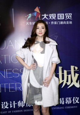 Hong Kong model and actress Lynn Hung poses at a fashion event by Daguan International Business Center in Zhengzhou city, central China's Henan province, 28 December 2014.