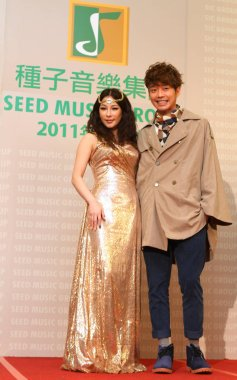 Taiwanese singer Landy Wen and Malaysian singer Nicholas Teo pose during a year-end dinner party by Seed Music Group in Taipei, Taiwan, 17 January 2012.