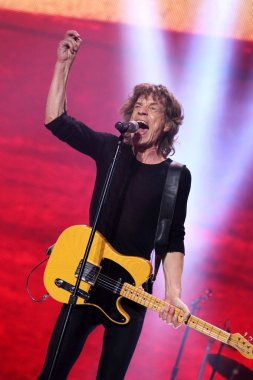 Mick Jagger of English rock band The Rolling Stones performs at the concert of their world tour, 14 On Fire, in Shanghai, China, 12 March 2014.