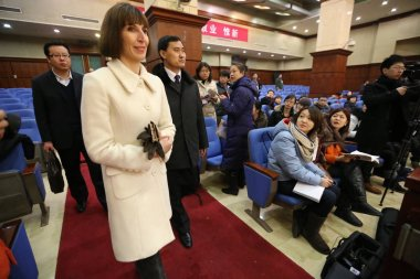 Kim Lee, front, wife of Crazy English founder Li Yang, arrives for a trial at the Beijing Chaoyang District Peoples Court in Beijing, China, 3 February 2013