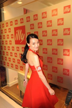 Taiwanese actress Shu Qi poses during the opening ceremony of a new shop of Italian coffee brand illy in Hong Kong, China, 11 July 2013.