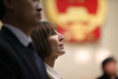 Kim Lee, back, wife of Crazy English founder Li Yang, looks on during the trial at the Beijing Chaoyang District Peoples Court in Beijing, China, 3 February 2013