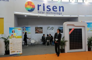 An employee is seen at the stand of Risen Energy during the SNEC 5th (2011) International Photovoltaic Power Generation Conference and Exhibition in Shanghai, China, 24 February 2011