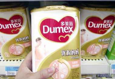 A customer shops for Dumex milk powder of Danone at a supermarket in Nanjing city, east Chinas Jiangsu province, 14 July 2013