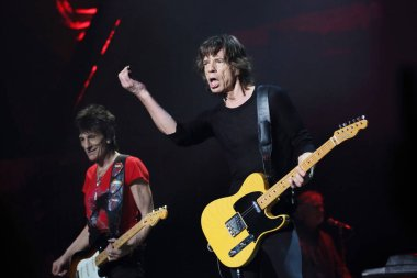 Mick Jagger, right, and Ronnie Wood of English rock band The Rolling Stones perform at the concert of their world tour, 14 On Fire, in Shanghai, China, 12 March 2014.