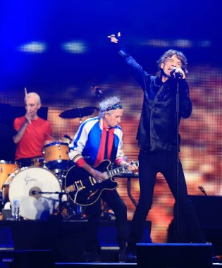 (From front) Mick Jagger, Keith Richards and Charlie Watts of English rock band The Rolling Stones perform at the concert of their world tour, 14 On Fire, in Shanghai, China, 12 March 2014.