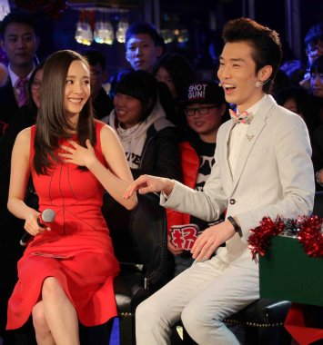 Chinese actress Yang Mi, left, laughs during a fan meeting in Shanghai, China, 22 December 2014.