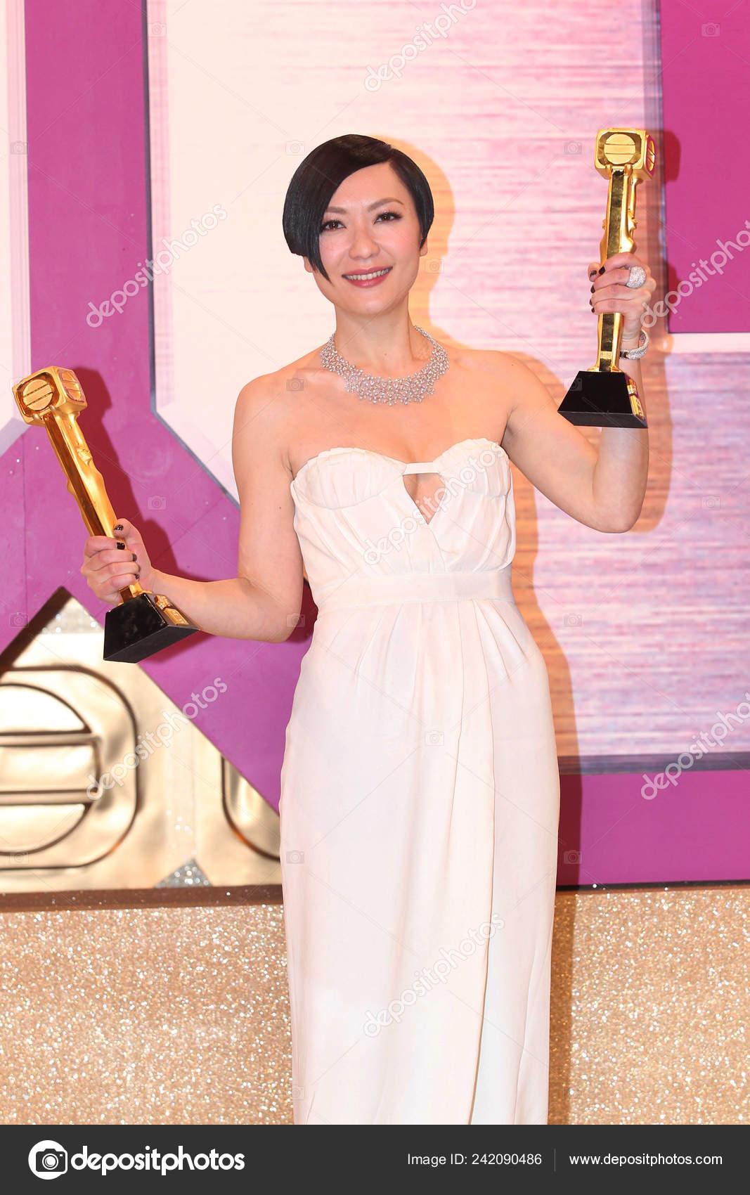 Hong kong actress kristal tin kisses her trophies best actress.