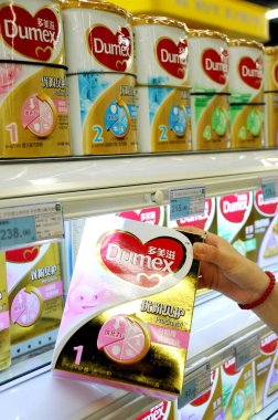 ----A customer shops for Dumex baby formula of Danone at a supermarket in Lianyungang  city, east Chinas Jiangsu province, 5 August 2013.