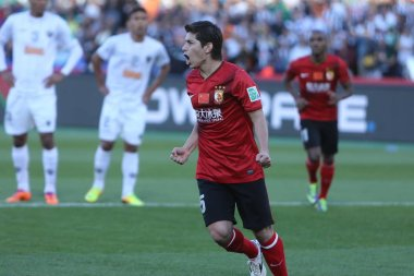 Dario Conca of Chinas Guangzhou Evergrande roars after scoring during the 3rd place match against Brazils Atletico Mineiro at the FIFA Club World Cup in Marrakesh, Morocco, 21 December 2013