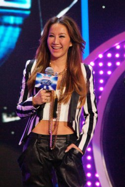 American singer Coco Lee smiles during the first episode of Chinese reality singing TV show, Chinese Idol, in Shanghai, China, 22 April 2013