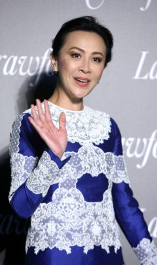 Hong Kong actress Carina Lau waves during the opening ceremony for the flagship store of Lane Crawford in Shanghai