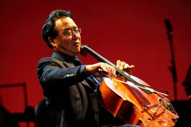 French American cellist Yo-Yo Ma plays the cello during a concert in Guangzhou, south Chinas Guangdong province, 4 March 2012.