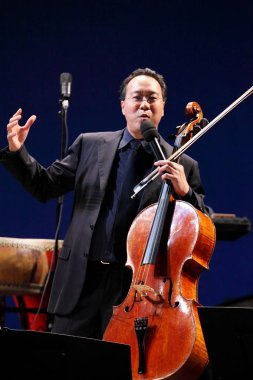 French American cellist Yo-Yo Ma speaks during a concert in Guangzhou, south Chinas Guangdong province, 4 March 2012.