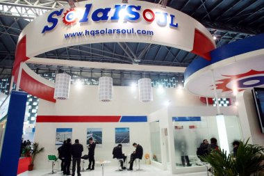 People visit the stand of SolarSoul (Zhejiang Global Photovoltaic Technology Co., Ltd.) during the 7th AsiaSolar Photovoltaic Industry Exhibition 2012 in Shanghai, China, 21 March 2012