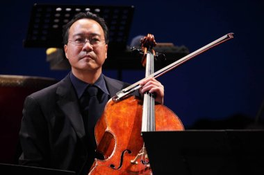 French American cellist Yo-Yo Ma is pictured during a concert in Guangzhou, south Chinas Guangdong province, 4 March 2012.
