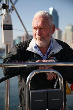--File--Robin Knox-Johnston, founder of the Clipper Round the World Yacht Race, poses in Qingdao, east Chinas Shandong province, 28 February 2012.