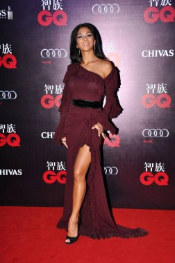 US dancer and actress Nicole Scherzinger poses on the red carpet as she arrives for the award ceremony of the 2012 GQ Men of the Year Event in Beijing, China, 7 September 2012.