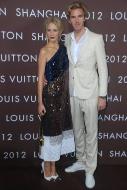 British model Poppy Delevigne, left, and boyfriend James Cook pose on the red carpet before the Louis Vuitton 2012 Autumn/Winter fashion show at the North Bund in Shanghai, China, 19 July 2012.