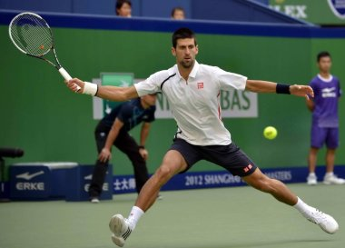 Novak Djokovic of Serbia returns a shot against Feliciano Lopez of Spain in their third round match of the mens singles during the 2012 Shanghai Rolex Masters tennis tournament in Shanghai, China, 11 October 2012