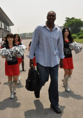 Retired American basketball player Horace Grant arrives for a prmotional activity in Shanghai, China, 5 May 2012