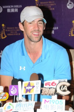 US Olympic swimming champion Michael Phelps attends a press conference for the 2012 Mission Hills World Celebrity Pro-Am golf tournament in Haikou city, south Chinas Hainan province, 18 October 2012.