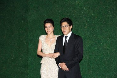 Chinese diving queen Guo Jingjing, left, her husband  Kenneth Fok hold a wedding ceremony in Hong Kong, 11 November, 2012