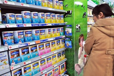 A Chinese shopper looks at Mead Johnson baby formula at a supermarket in Zouping county, Binzhou city, east Chinas Shandong province, 27 November 2011