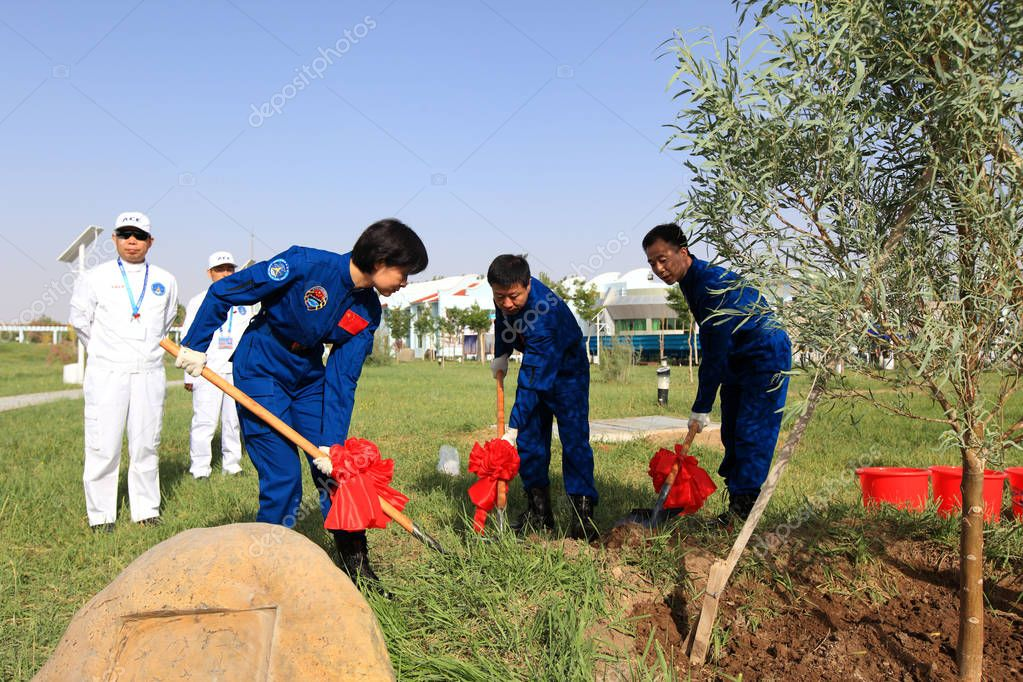 (From left) Liu Yang, Liu Wang and Jing Haipeng, astronauts of the Shenzhou IX, attend a tree planting activity at the Jiuquan Satellite Launch Center near Jiuquan city, northwest Chinas Gansu province, 10 June 2012