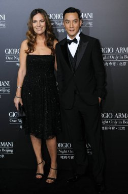 Hong Kong actor Daniel Wu and U.S. actress Brooke Shields pose at the red carpet ceremony before the Giorgio Armani One Night Only in Beijing fashion show at the 798 Art Zone in Beijing, China, 31 May 2012.