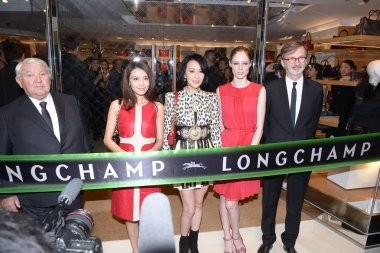 Hong Kong actor Carina Lau, center, Chinese actress Gao Yuanyuan, second left, Canadian model Coco Rocha, second right, and other guests pose at the opening ceremony of a new store of French fashion house Longchamp in Hong Kong, China, 17 October 201