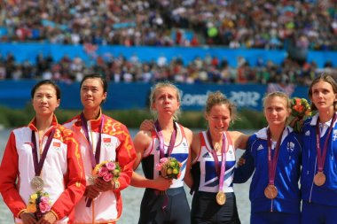 (From left) Silver medalists Xu Dongxiang and Huang Wenyi of China, gold medalists Sophie Hosking and Katherine Copeland of  Great Britain, bronze medalists Christina Giazitzidou and Alexandra Tsiavou of Greece pose in the award ceremony of the women
